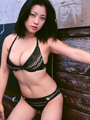 Flirtatious asian idol hides her big boobs in skimpy lingerie