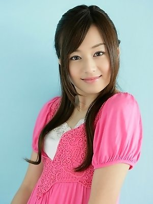 Beautiful gravure idol is adorable in cute little pink dress