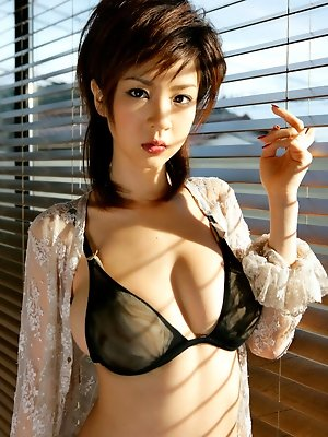 Juicey short haired asian babe with big heavy tits in lingerie